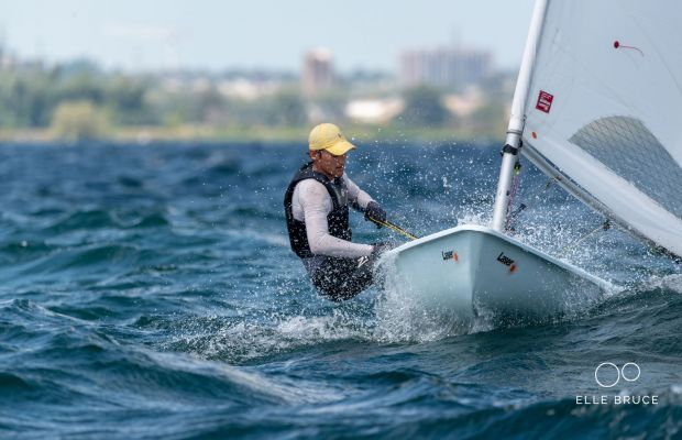 James bashes through the wave going upwind