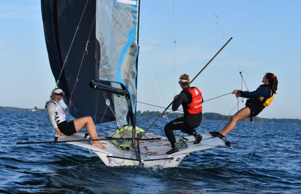 Mariah and Ali helping teaching the young women how to sail the FX!
